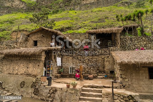 Alausi, Ecuador - March 2, 2019: Local people in huts with souvenirs at the railway station. Nariz del Diablo railway station.
