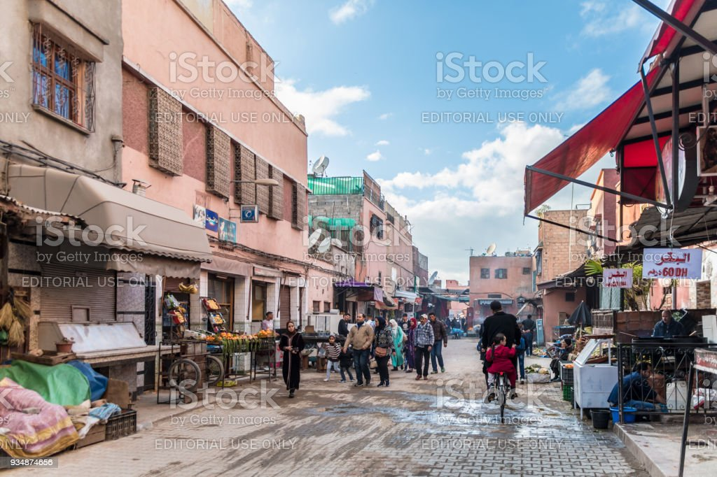 Local people on the back streets of the Medina in Marrakesh stock photo