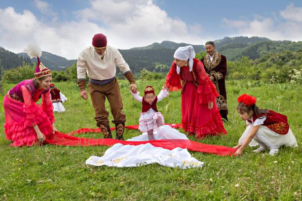 Local people showing Kazakh tradition, in Almaty, Kazakhstan. stock photo