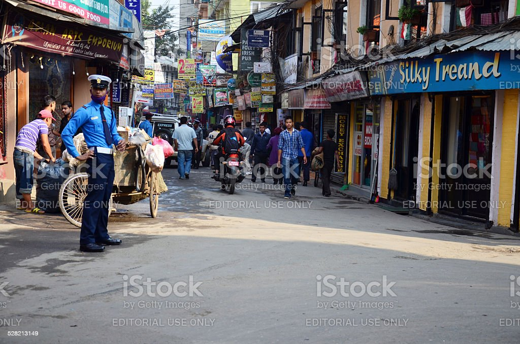 Local people walking on the street at Thamel market stock photo