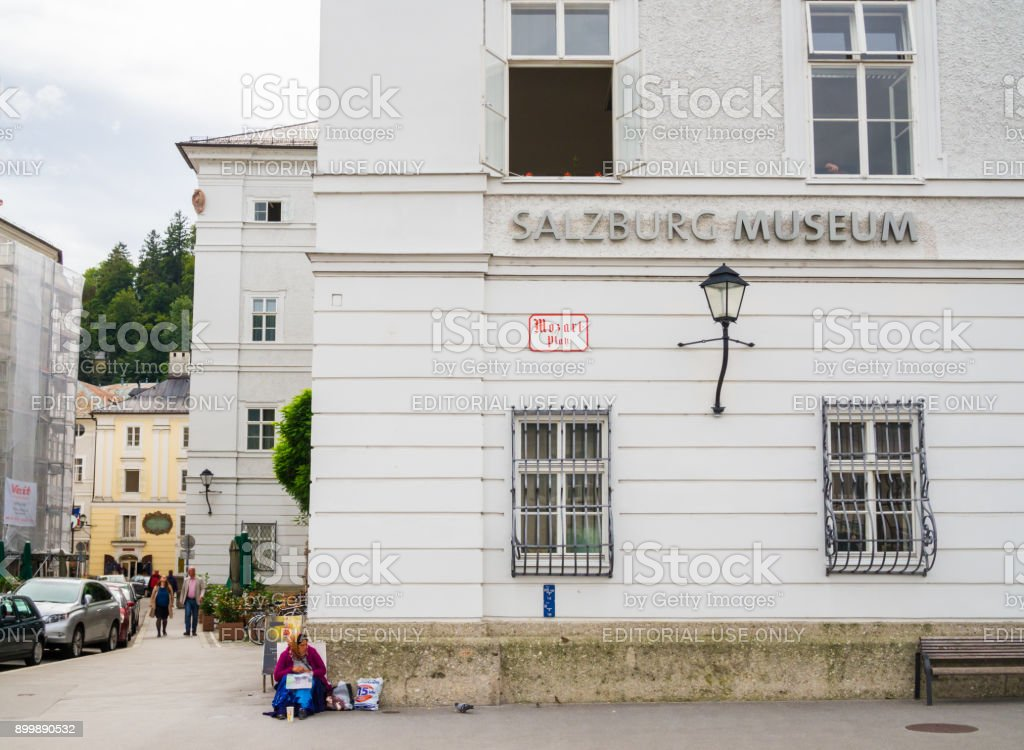 Local person sits in front of Salzburg Museum stock photo