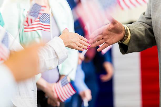local politician shaking hands with supporters at event - республиканская партия сша стоковые фото и изображения
