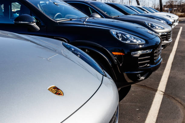 Local Porsche Dealership displaying new SUVs. Porsche Racing dates to the 1950s I Indianapolis - Circa March 2018: Local Porsche Dealership displaying new SUVs. Porsche Racing dates to the 1950s I porsche stock pictures, royalty-free photos & images