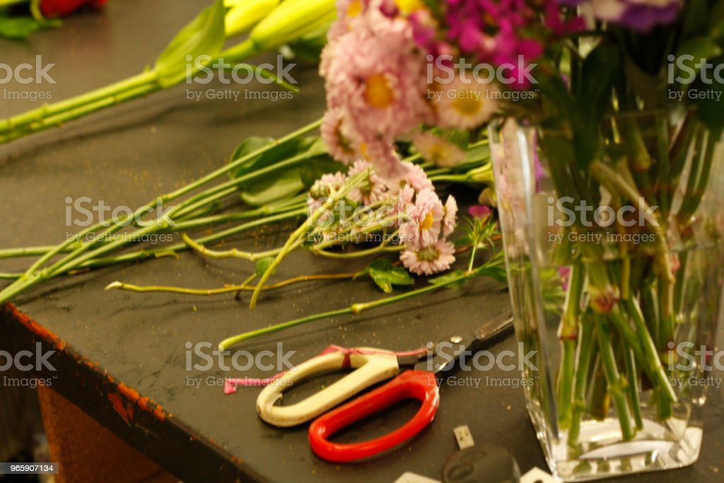 local professional florist arranging a personal bouquet using native Australian flowers and greenery - Royalty-free Adult Stock Photo