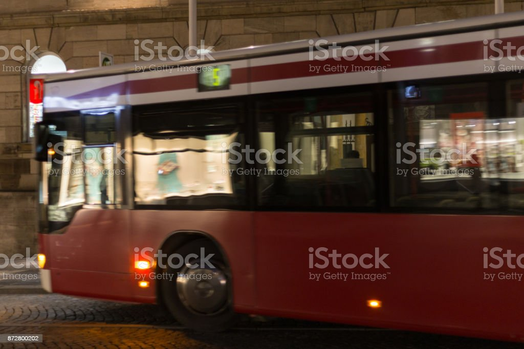 local public transport at night with citylights stock photo