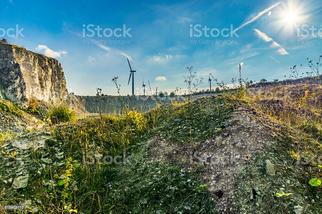 Local quarry with wind turbine – Foto
