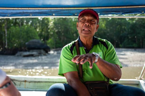 Local Ranger speaks at Mangroves tour in Kilim Karst Geoforest. stock photo