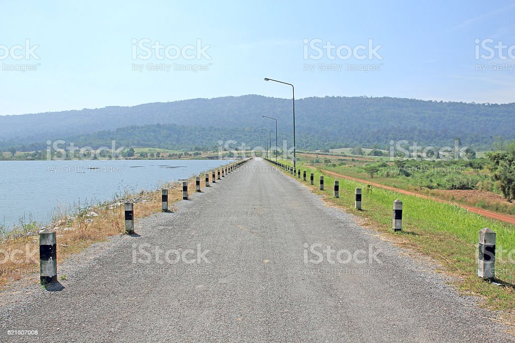 local road beside a dam foto stock royalty-free