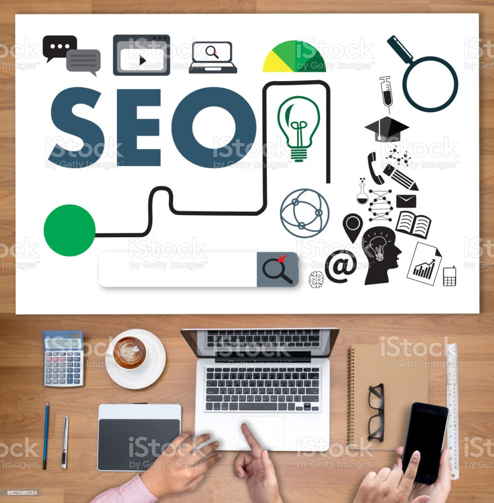 Local SEO Concept Business team hands at work with financial reports Links Global Hyperlink search engine optimization and a laptop stock photo