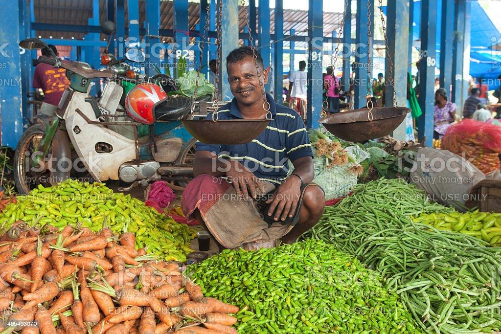 Local street vendor selling vegetables stock photo