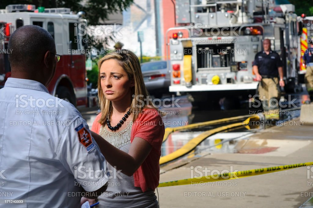 Local television reporter covering a fire royalty-free stock photo