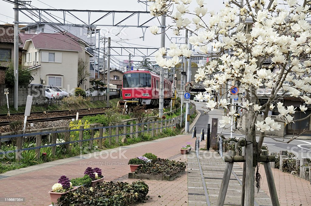 local train passing through japanese town royalty-free stock photo