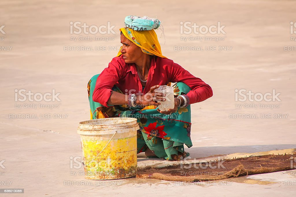 Local woman working in the second courtyard stock photo
