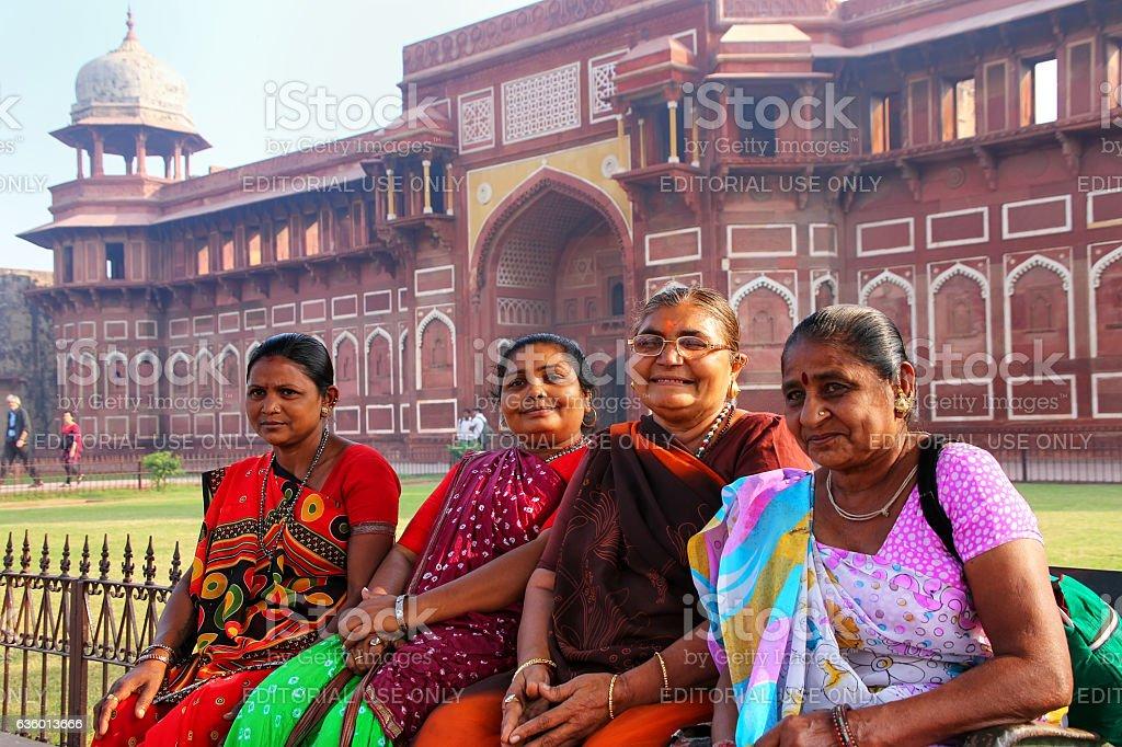 Local women sitting outside Jahangiri Mahal in Agra Fort, Uttar stock photo