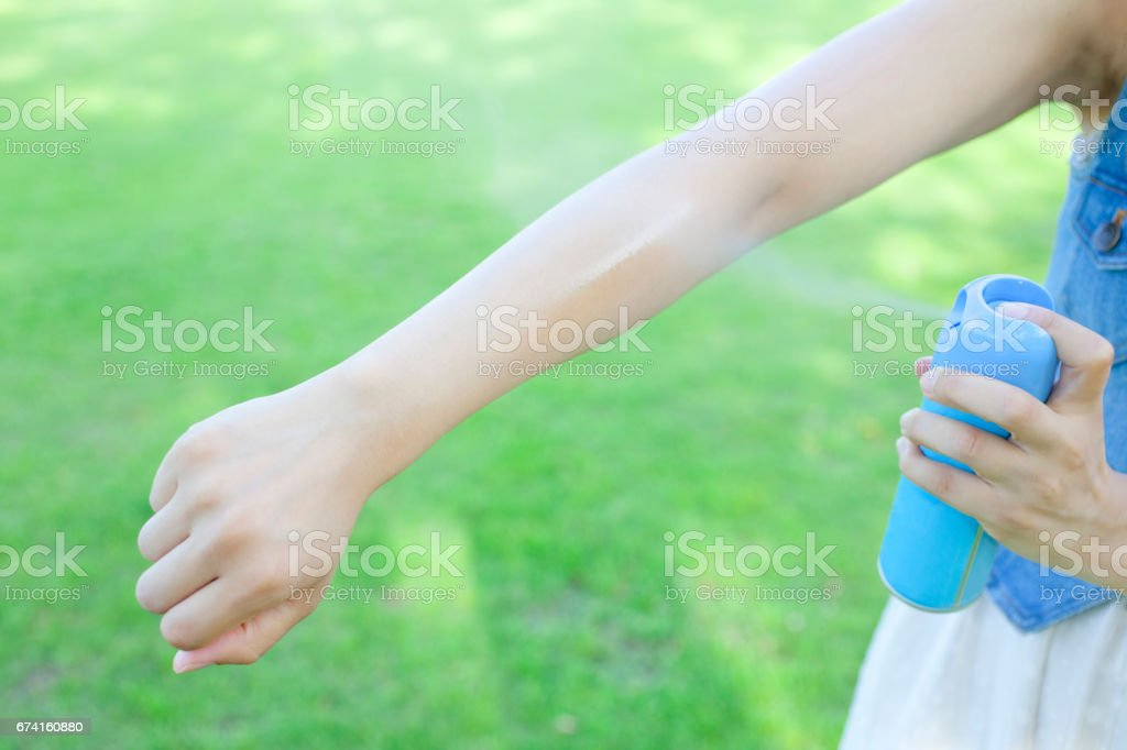 Local women to use insect repellent spray stock photo