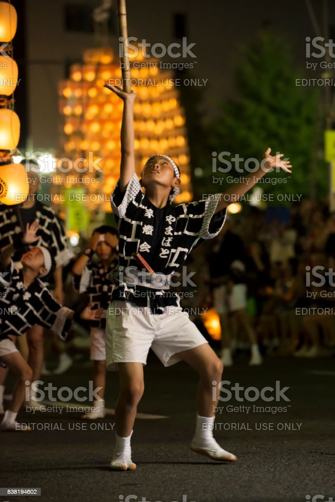 Local young boy lift up floating by himself in Kanto festival stock photo