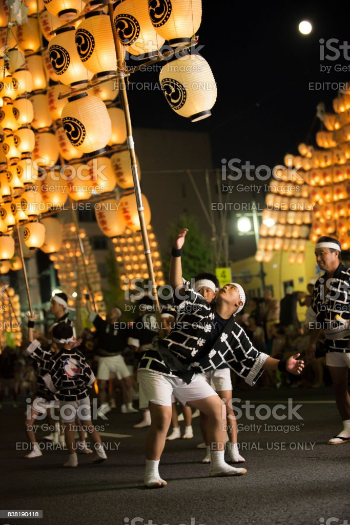 Local young men lift up floating by himself in Kanto festival stock photo