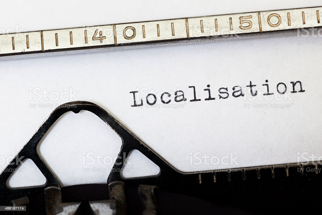 Localisation written on white paper with old typewriter. stock photo