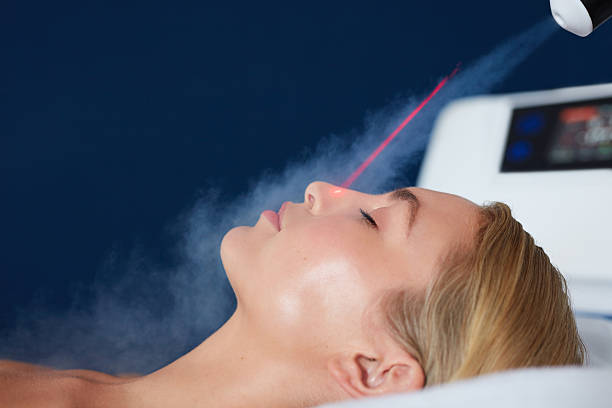 Localized cryotherapy on woman face Localized cryotherapy session on the face of young woman. Treatment uses vaporized nitrogen to lower the skin temperature. cryotherapy stock pictures, royalty-free photos & images