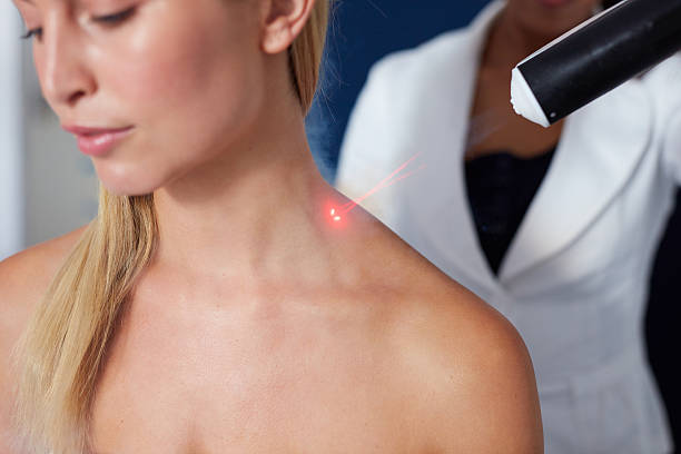 Localized cryotherapy session to the neck Closeup of localized cryotherapy session to the neck of young woman. Ice cold nitrogen vapors applied to neck cryotherapy stock pictures, royalty-free photos & images