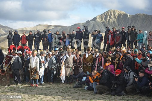 istock Locals and numerous tourists watching the Tiji festival in the capital of the Mustang kingdom Lo Mantang, Nepal. 1271324389