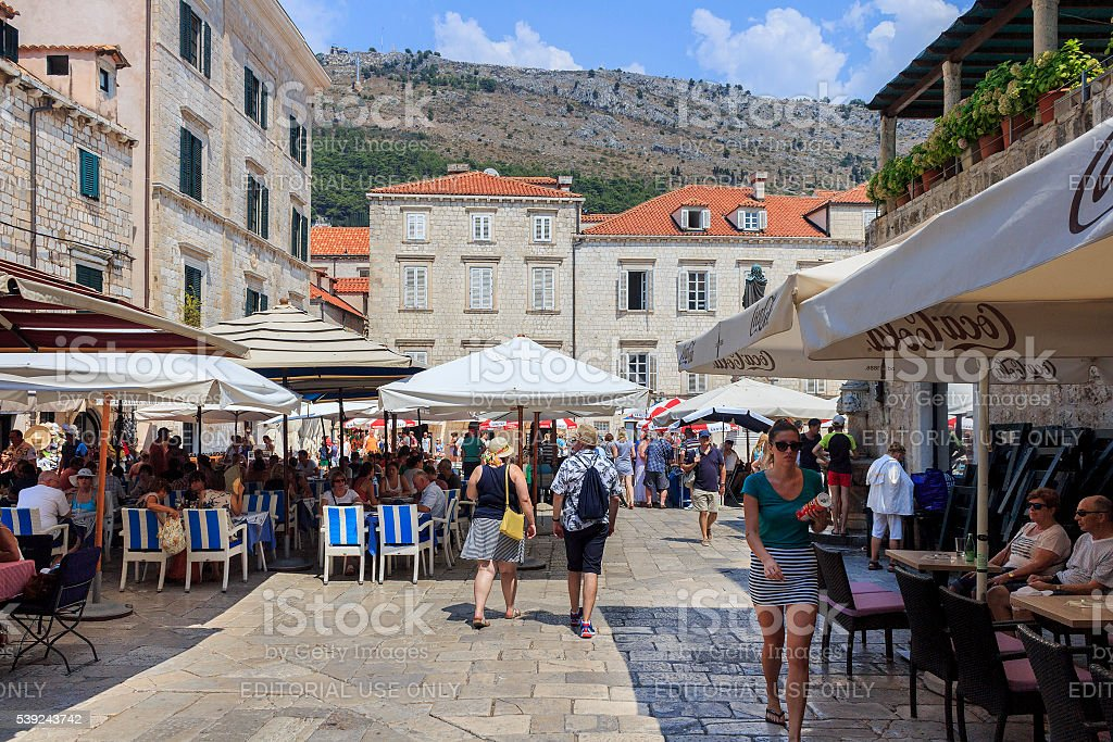 Locals and tourists at Gundulic Square royalty-free stock photo