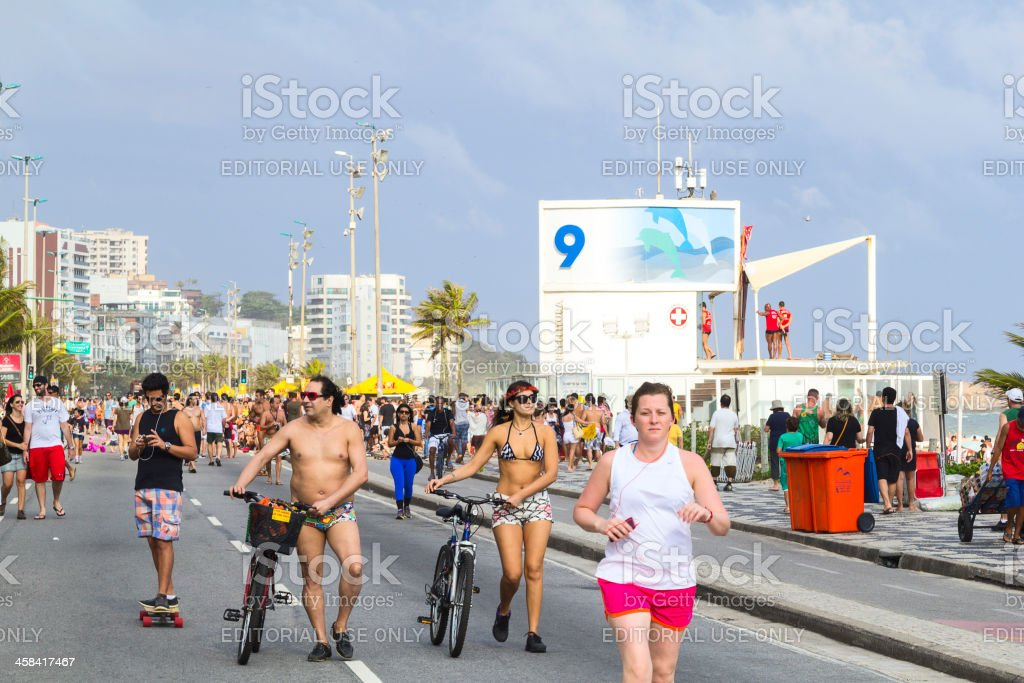 Locals and tourists at Ipanema beach royalty-free stock photo