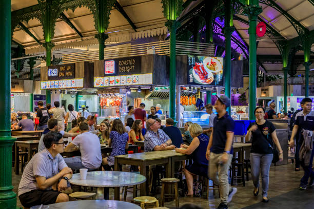 Locals and tourists, customers eating at the street hawker center in Lau Pa Sat Telok Ayer Market, Singapore stock photo