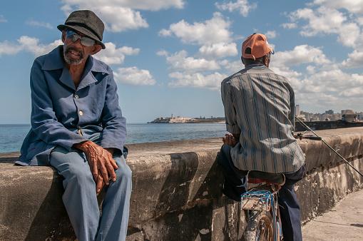La Havana, Cuba. 04-15-2018. Portrait of an old man sitting at the Malecon with a sea view in La Havana, Cuba.
