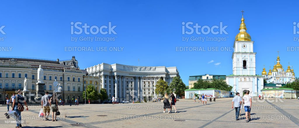 Locals and tourists walking near Ministry of Foreign Affairs of Ukraine, Monument to Princess Olga and St. Michael's Golden-Domed Monastery stock photo