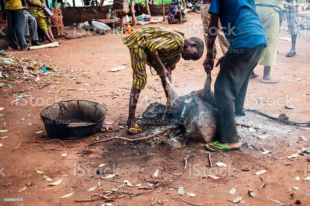 Locals cooking food. Benin, West Africa. stock photo
