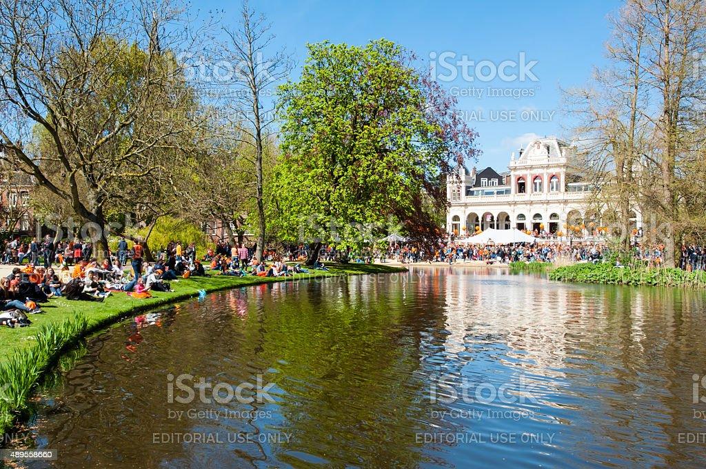 Locals in orange celebrate King's Day in Vondelpark, the Netherlands. stock photo