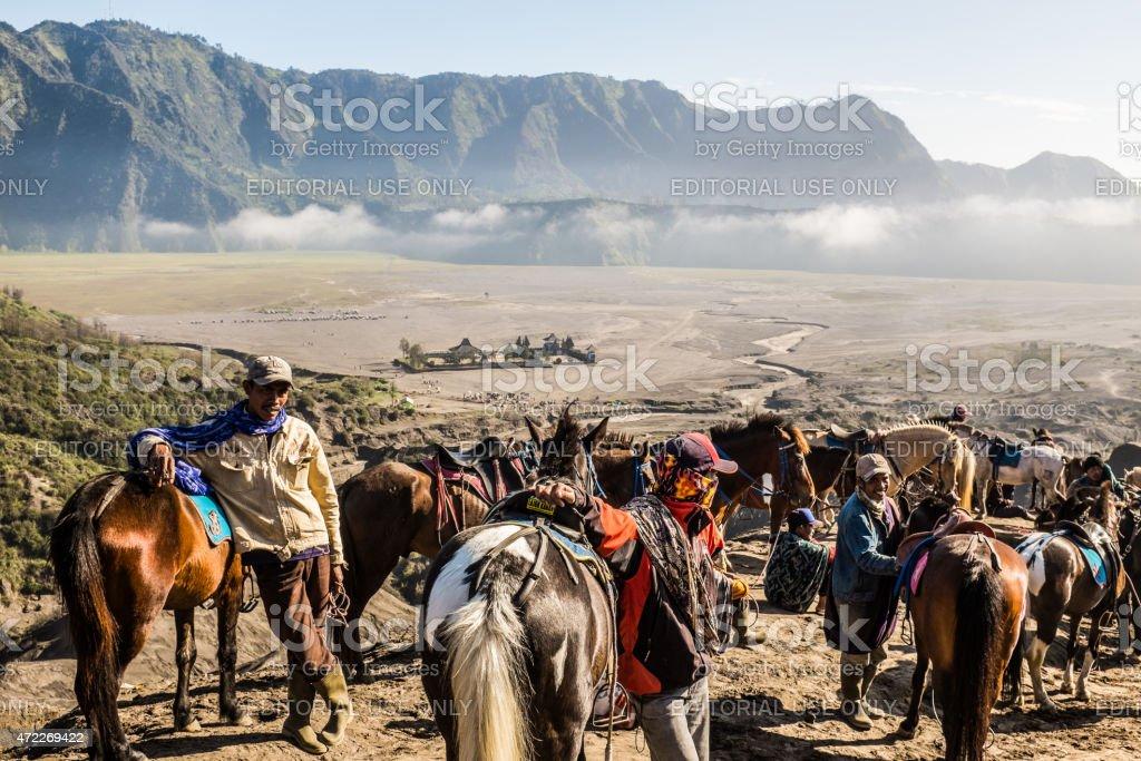 Locals near Bromo volcano crater stock photo
