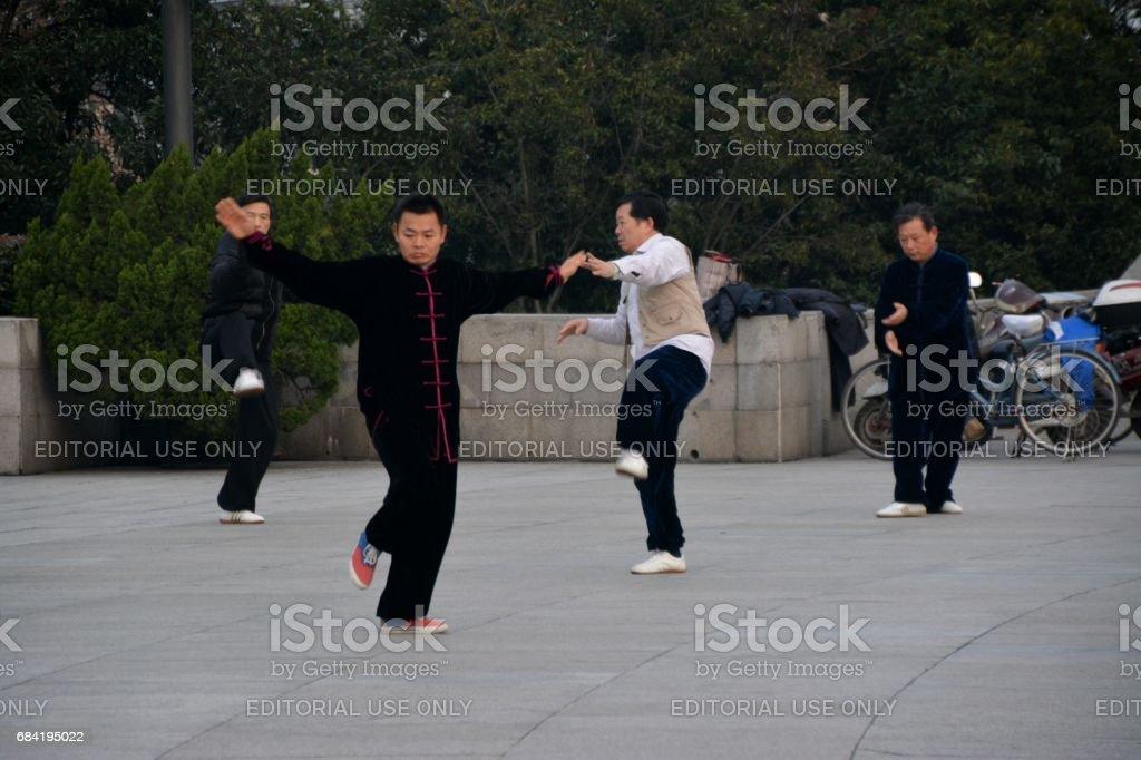 Locals performing Tai Chi on the Bund, Shanghai, China royalty-free stock photo