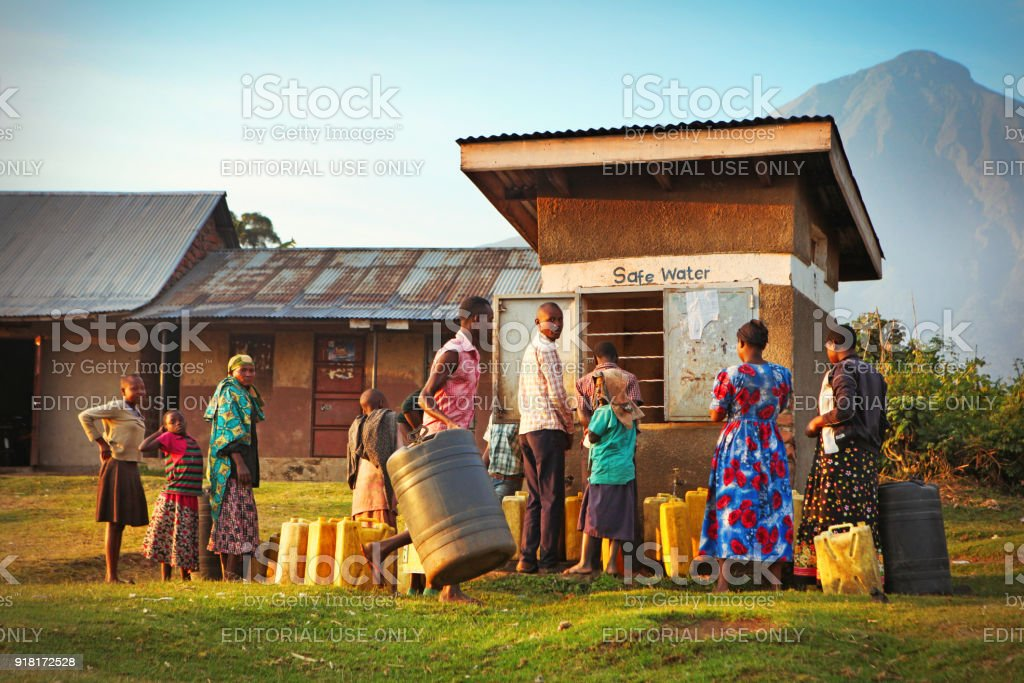 Locals waiting to get drinking water in Ugandan village stock photo