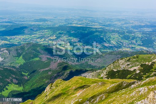 1130859000 istock photo Located in the valley, the village in Podhale seen from the trail in the Tatras. 1157118839
