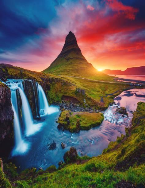 Location famous Kirkjufellsfoss waterfall, Iceland, Europe.