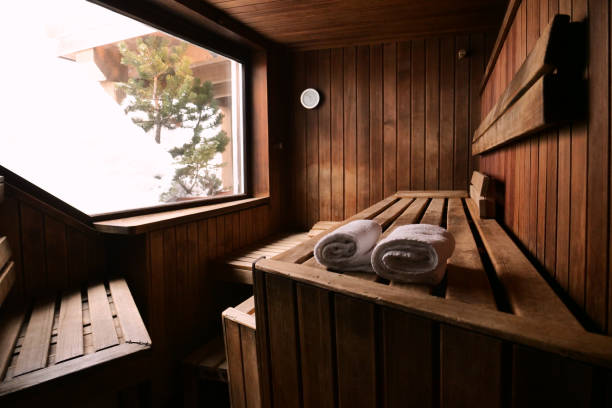 Location of a mountain wood sauna with a large window in which to relax. Location of a mountain wood sauna with a large window in which to relax. Concept of: interior design, relaxation, sauna, spa sauna stock pictures, royalty-free photos & images
