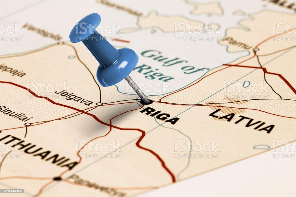 Location Riga. Blue pin on the map. stock photo