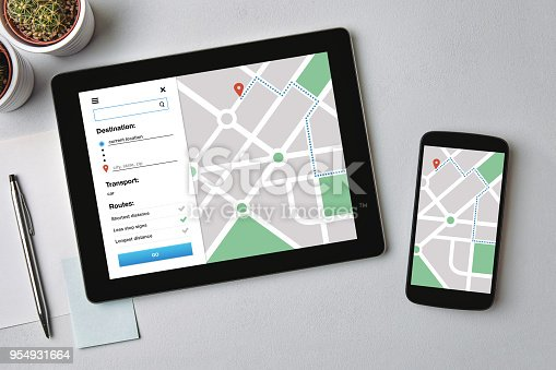 1134879628 istock photo Location tracker concept on tablet and smartphone screen. GPS map navigation app 954931664