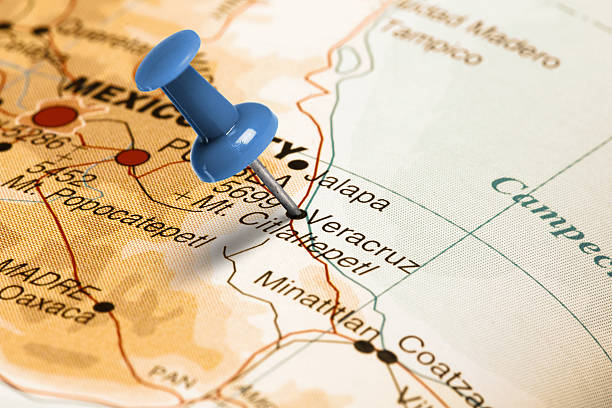 Location Veracruz. Blue pin on the map. Series: Travel the world and visit major cities. Blue thumbtack (push pin) that is stuck in a map, which marks the city of Veracruz, Mexico. The map is toned in pastel colors. Concept: Planning travel destinations or journey planning. Close-up view. Studio shot. Landscape orientation. veracruz stock pictures, royalty-free photos & images