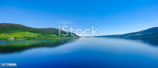 Loch Ness, a large, deep, freshwater loch in the Scottish Highlands worldwide famous for its castle, Castle Urquhart, and for its monster, the shy