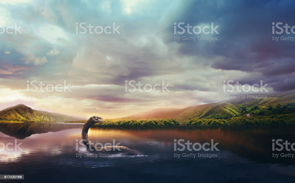 Loch Ness Monster in the lake at sunset stock photo