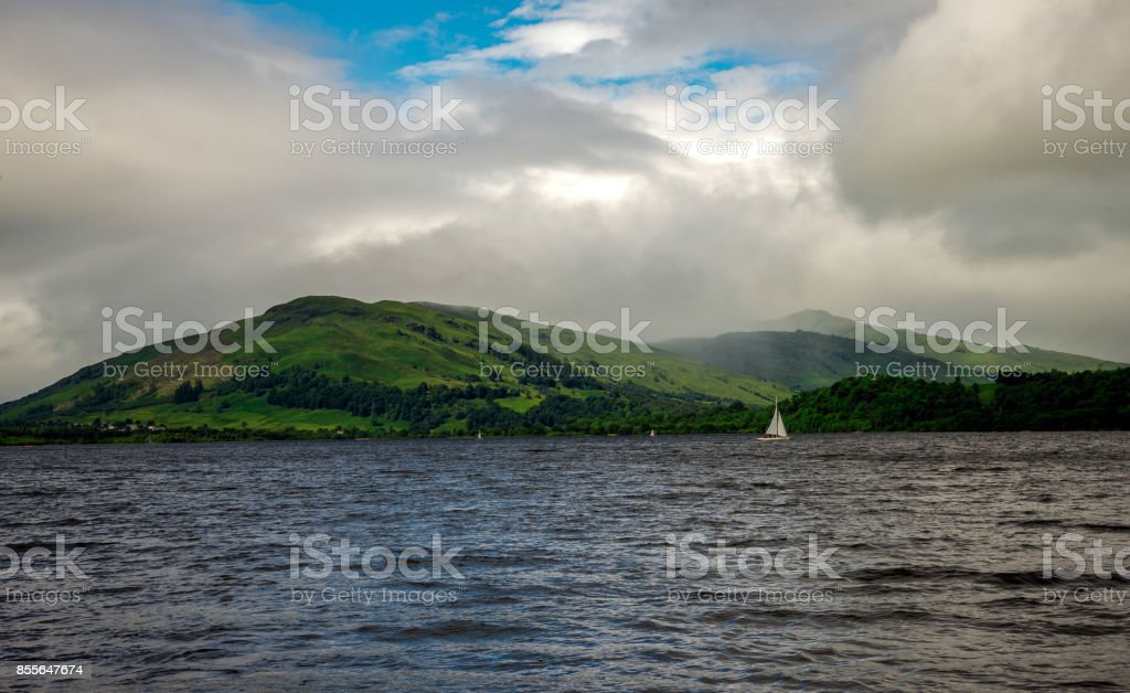 Loch Tay lake waters, yachts, village and surrounding coastline, central Scotland stock photo