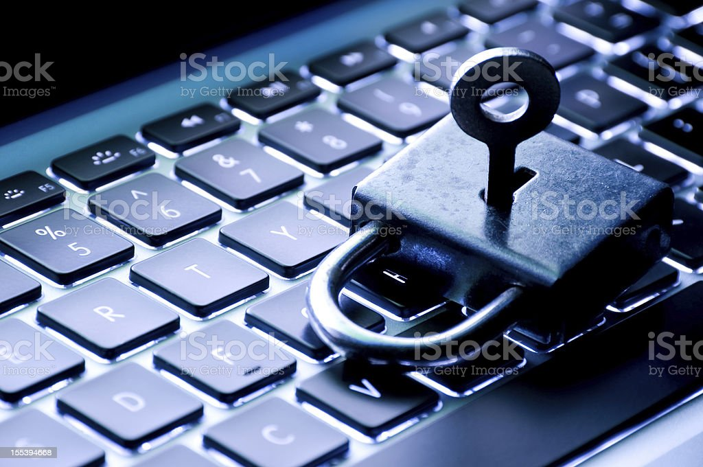 A lock and key on top of the keyboard royalty-free stock photo