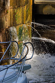 istock Lock chamber with the bow on a boat 1331044140