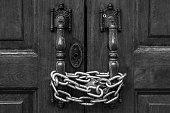 istock Lock down the door by iron chain 1271099301