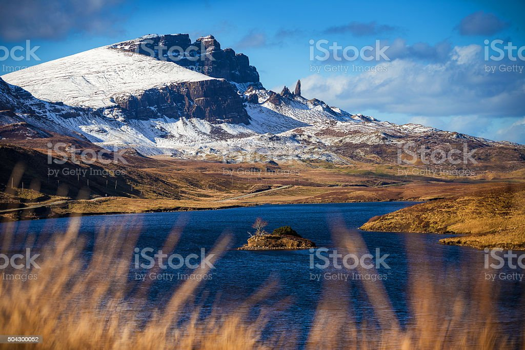 Lock Fada and the snowy Old Man of Storr, Scotland stock photo