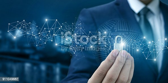 istock Lock for protection of the network in the hands of a businessman . 911049682
