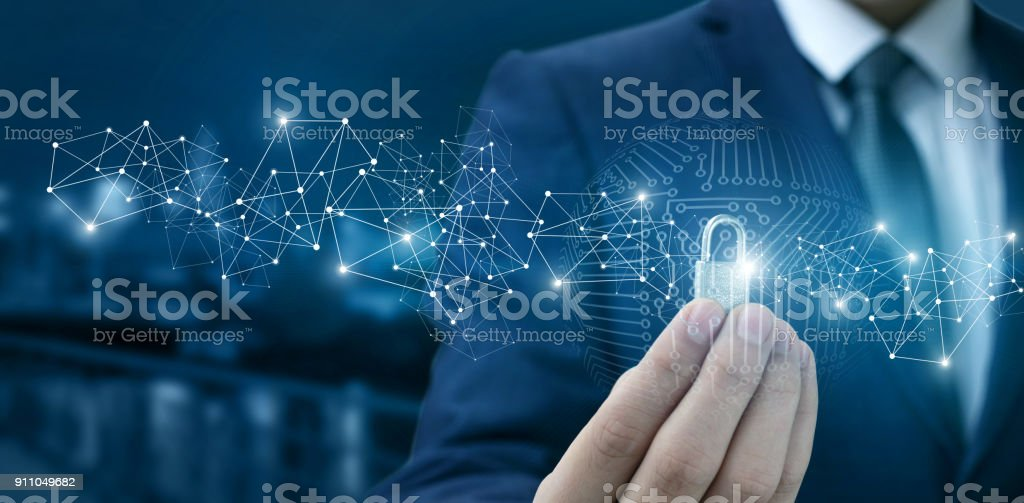 Lock for protection of the network in the hands of a businessman . stock photo